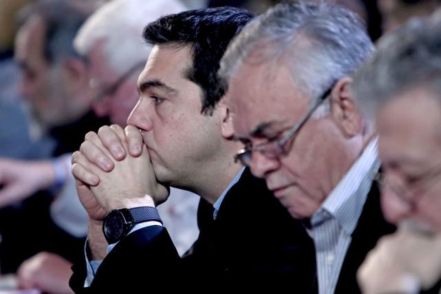 À la suite de difficiles négociations, les dirigeants... (Agence France-Presse)