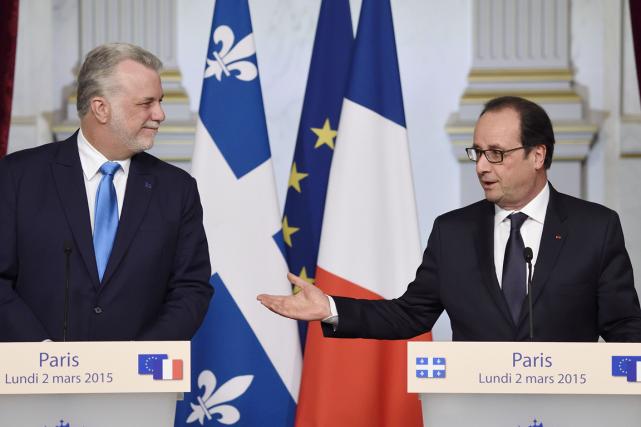 Le président François Hollande veut que le Québec soit présent à la conférence... (PHOTO AFP)