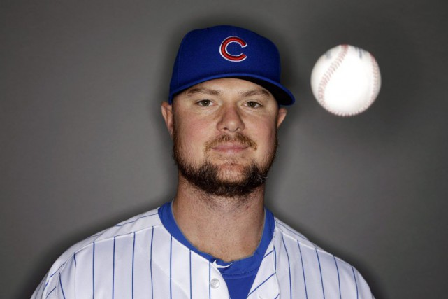 Jon Lester... (PHOTO MORRY GASH, AP)