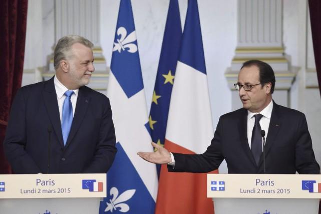 Le premier ministre du Québec Philippe Couillard et... (PHOTO ERIC FEFERBERG, AGENCE FRANCE-PRESSE)