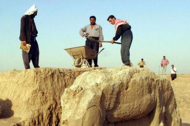 Dans cette photo datant de 2003, Ddes travailleurs... (PHOTO Karim SAHIB, Archives AFP)