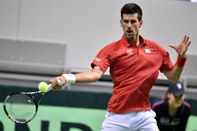 Novak Djokovicl'a emporté 6-3, 6-2, 6-4 aux dépens... (Photo Andrej Isakovic, AFP)