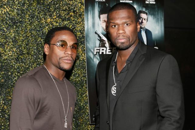 Le boxeur Floyd Mayweather et le rappeur 50... (Photo archives AP)