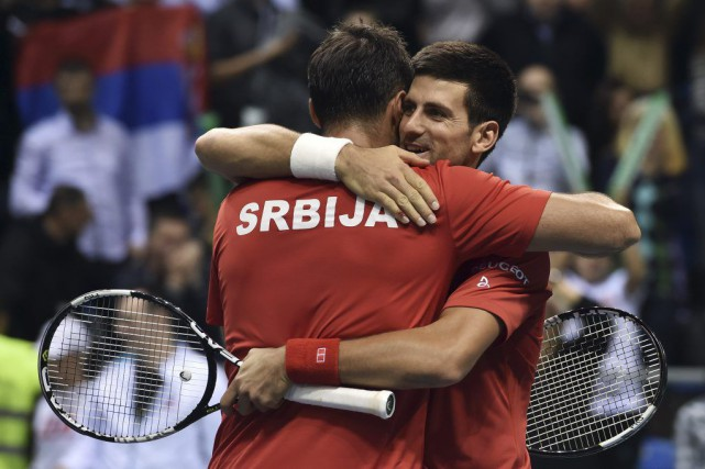Novak Djokovic (à droite) et Nenad Zimonjic.... (PHOTO ANDREJ ISAKOVIC, AFP)