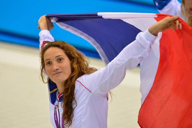 Camille Muffat a remporté tois médailes aux JO... (PHOTO AFP)