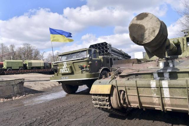 «La partie ukrainienne a retiré la majorité de... (PHOTO SERGEI SUPINSKY, AGENCE FRANCE-PRESSE)