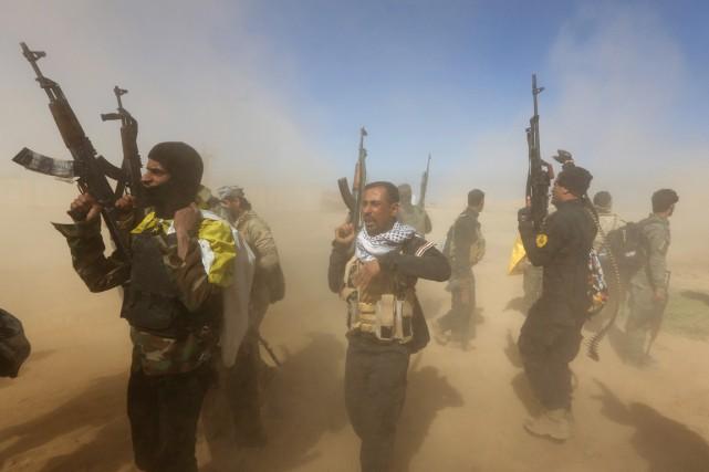 Parmi les hommes qui ont pénétré dans Qadisiyah... (PHOTO AHMAD AL-RUBAYE, AFP)