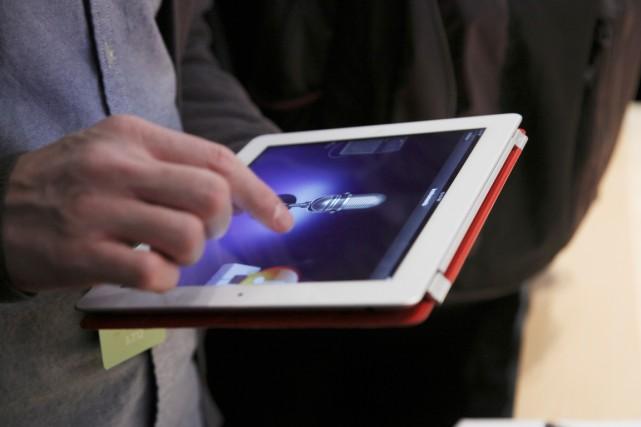 L'entreprise Lens de Zhou Qunfeifabrique des écrans tactiles... (PHOTO ARCHIVES THE NEW YORK TIMES)