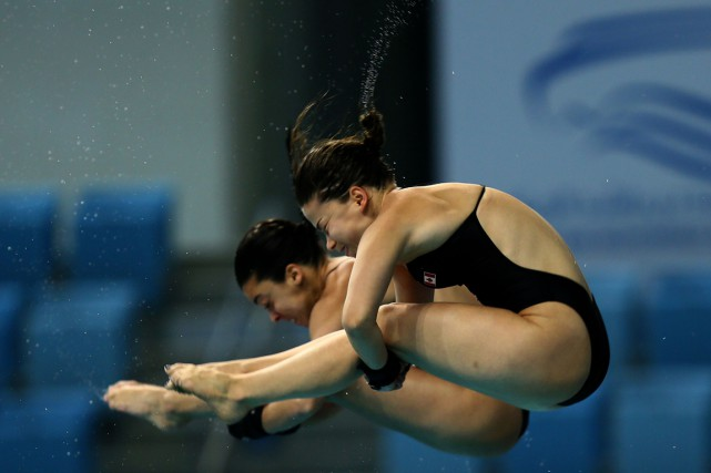 Meaghan Benfeito et Roseline Filion... (PHOTO MARWAN NAAMANI, ARCHIVES AFP)