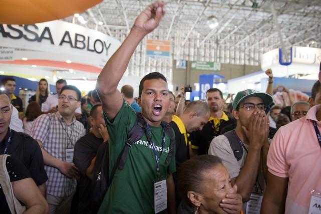 Mardi, des opposants à laprésidente Dilma Rousseff ont... (Photo Andre Penner, AP)