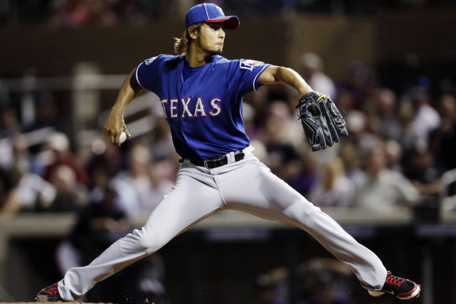 L'as lanceur Yu Darvish sera opéré au coude.... (Photo d'archives, Associated Press)