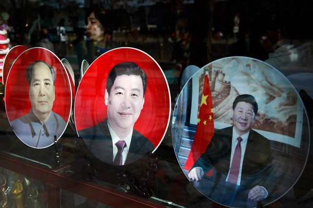 Sous la présidence de Xi Jinping (qui apparaît... (PHOTO ANDY WONG, ASSOCIATED PRESS)