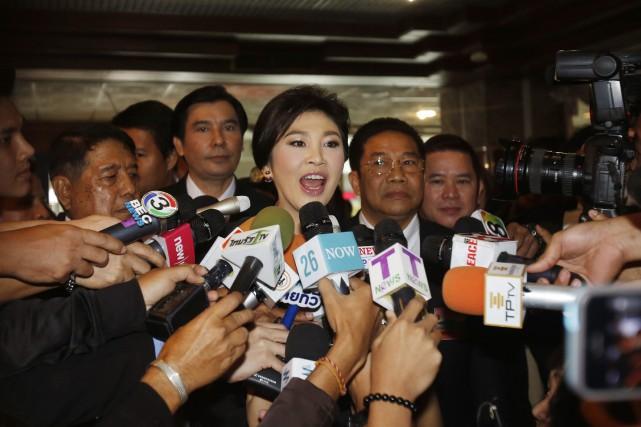 Yingluck avait été mise en examen mi-février pour... (PHOTO ARCHIVES AP)