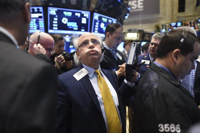 Wall Street a fini la séance en ordre dispersé jeudi, au lendemain des annonces... (PHOTO TIMOTHY A. CLARY, AFP)