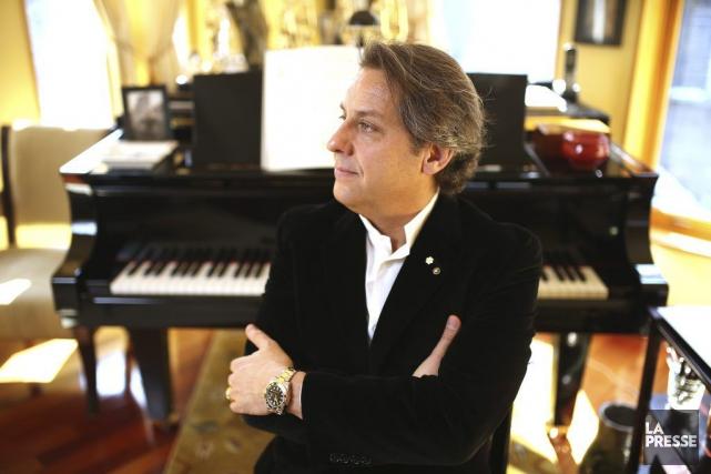 Le pianiste Alain Lefèvre, assis devant le rutilant... (PHOTO MARTIN CHAMBERLAND, ARCHIVES LA PRESSE)