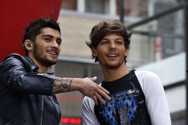Zayn Malik (à gauche) avec Louis Tomlinson, de... (Photo BRENDAN MCDERMID, Reuters)