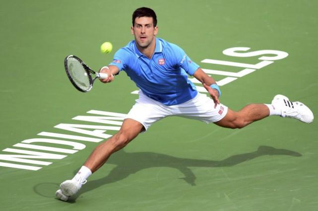 Pour Novak Djokovic, il s'agit d'unequatrième victoire àIndian... (PHOTO FREDERIC J. BROWN, AFP)
