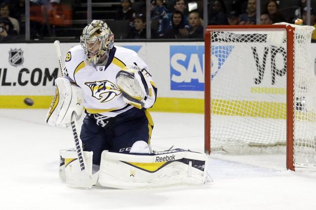 Pekka Rinne est en plein coeur d'un course... (Photo Marcio Jose Sanchez, AP)