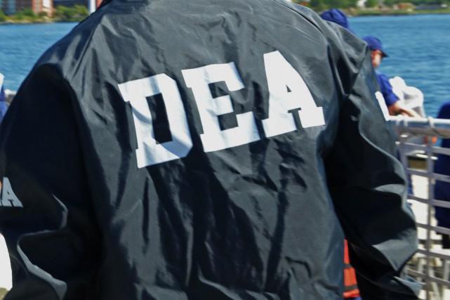 Le rapport relate notamment comment une dizaine d'agents... (PHOTO ARCHIVES AFP)