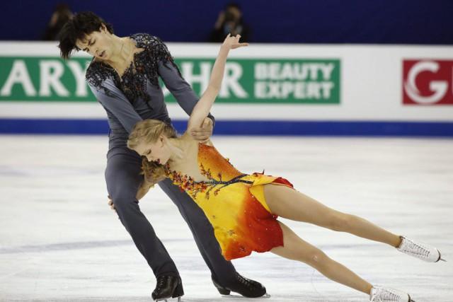 Kaitlyn Weaver et Andrew Pojefaisaient figure de favoris... (PHOTO NG HAN GUAN, AP)