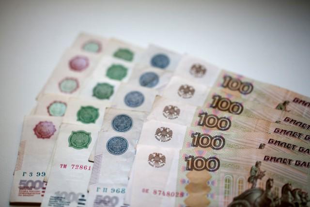Autour de 57 roubles pour un dollar vendredi,... (Photo Andrey Rudakov, Archives Bloomberg)