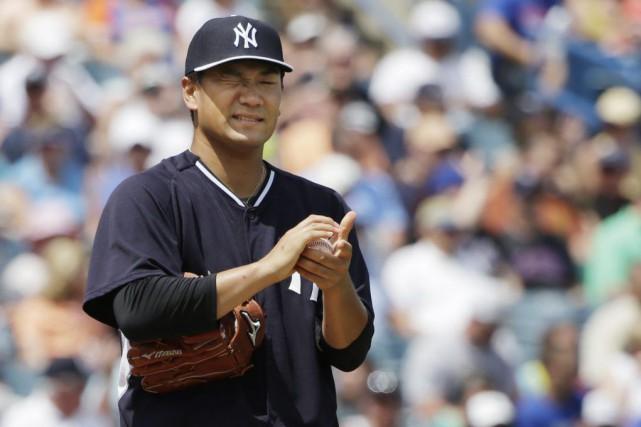 La saison dernière, Tanaka a montré une fiche... (PHOTO KATHY WILLENS, AP)