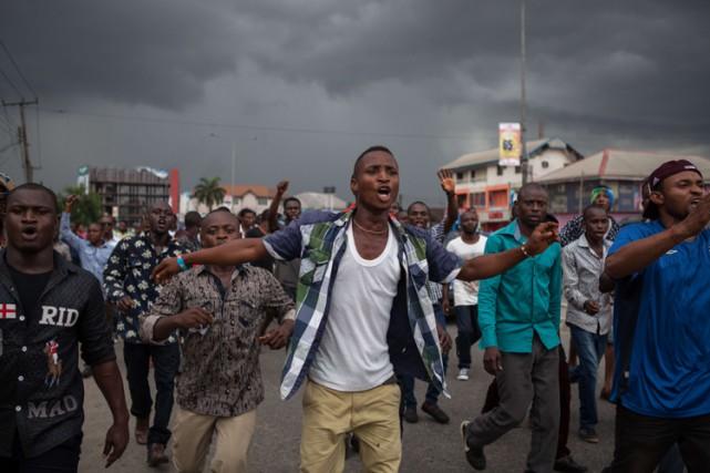 Des milliers de partisans du principal parti d'opposition au Nigeria ont... (Photo: AFP)