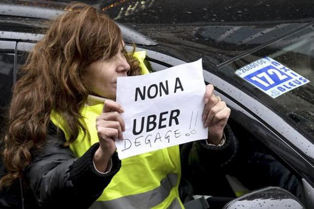 Uber fait valoir que les efforts déployés par... (PHOTO ARCHIVES AFP)