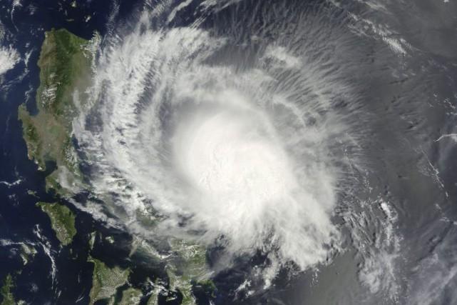 Le typhon devrait se traduire par des pluies... (PHOTO NORMAN KURING, AFP/NASA)