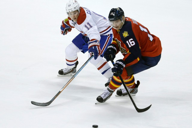 Brendan Gallagher et Aleksander Barkov... (PHOTO LYNNE SLADKY, ARCHIVES AP)