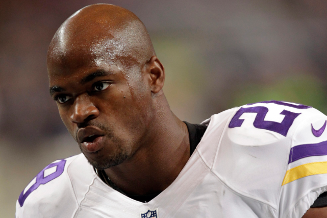 Adrian Peterson... (Photo Tom Gannam, archives AP)
