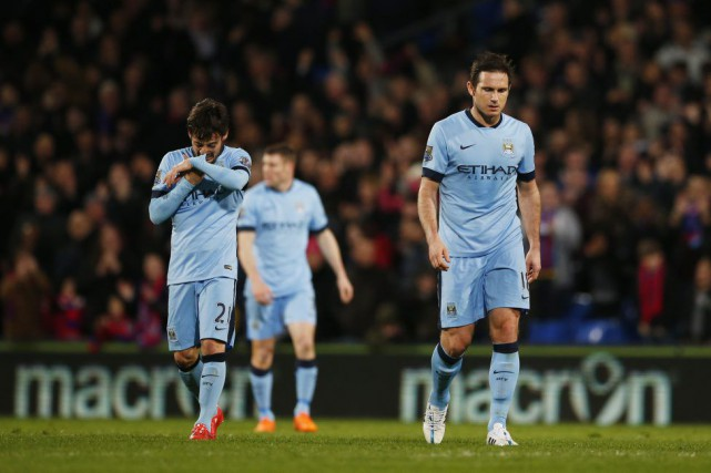 Frank Lampard et David Silva... (Photo John Sibley, Reuters)