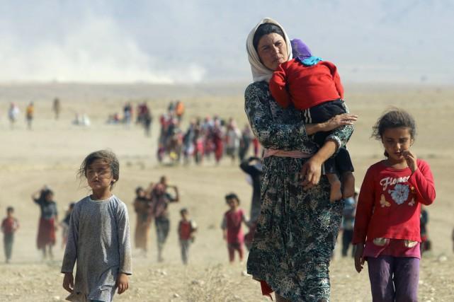 Des membres de la communauté yézidis, fuyant les... (PHOTO RODI SAID, ARCHIVES REUTERS)