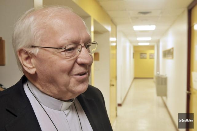 L'évêque du Diocèse de Chicoutimi, Mgr André Rivest,... ((Photo Le Quotidien-Rocket Lavoie))