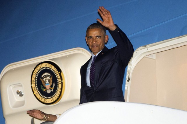 Barack Obama à son arrivée à l'aéroport international... (Photo: AP)