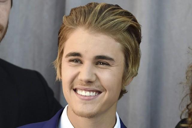 Bieber est accusé d'avoir ordonné à ses gardes... (PHOTO JORDAN STRAUSS, ARCHIVES PC)