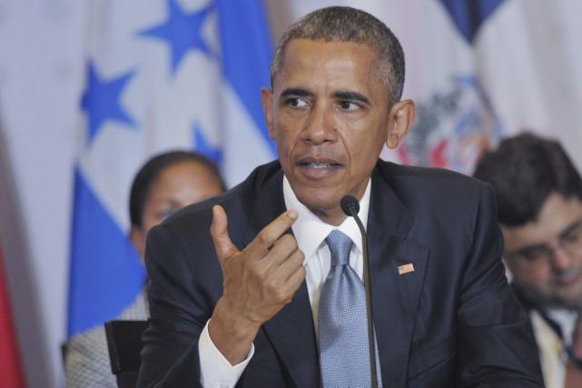 Devant la société civile, Barack Obama a voulu souligner vendredi l'avènement... (Photo AFP)