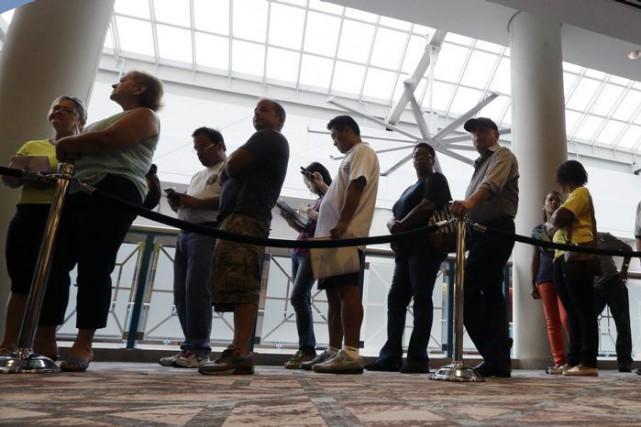Le taux de chômage s'est très légèrement accru, le mois dernier, du côté... (Mel Evans, Archives Associated Press)