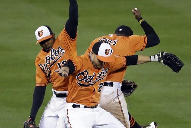 Les joueurs des Orioles festoient après leur victoire.... (Photo Patrick Semansky, AP)
