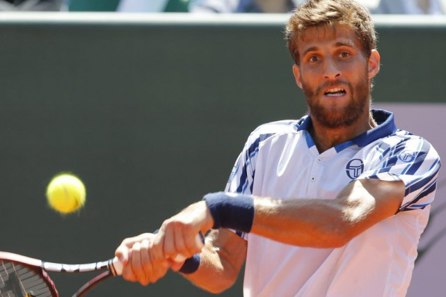 Martin Klizan... (Photo Abdeljalil Bounhar, AP)