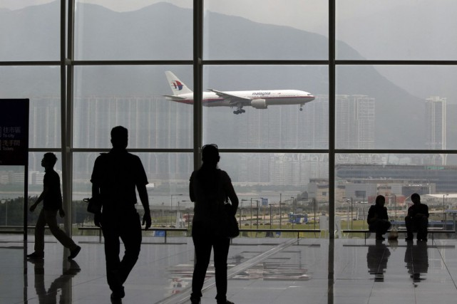 L'aéroport de Hong Kong... (Photo d'archives, Reuters)