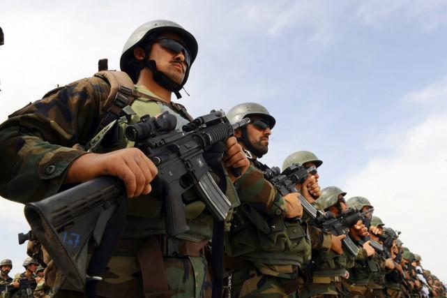 «Dix-huit membres des forces de sécurité ont malheureusement... (PHOTO AREF KARIMI, ARCHIVES AFP)