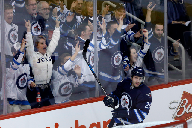 Les Jets de Winnipeg comptent sur des partisans... (Photo John Woods, PC)