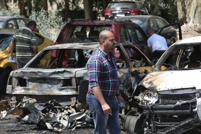 Six attentats à la voiture piégée dans l'agglomération de Bagdad, dont l'un à... (Photo: AP)