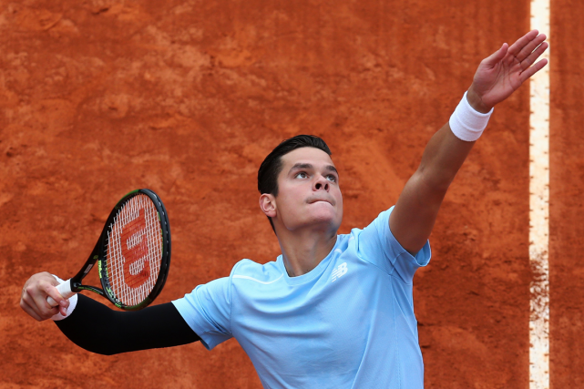 Milos Raonic... (Photo Jean-Christophe Magnenet, AFP)