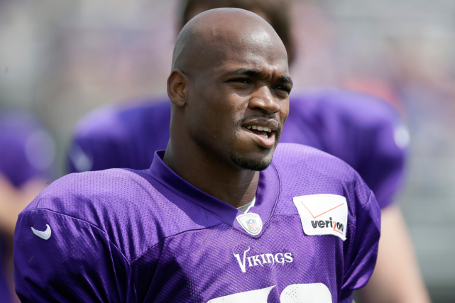 Adrian Peterson... (Photo Charlie Neibergall, archives AP)