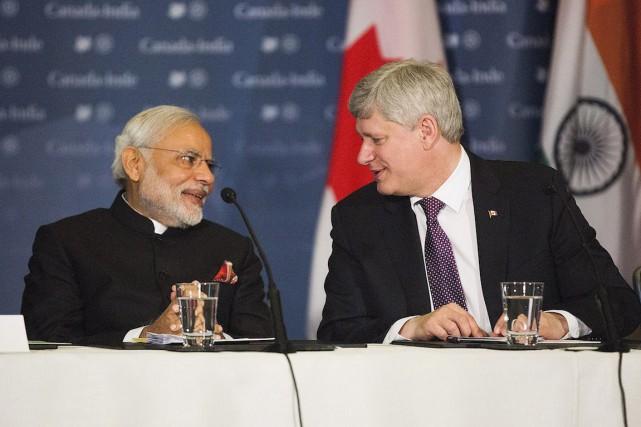 Stephen Harper etNarendra Modi, jeudi à Toronto.... (Photo Michelle Siu, La Presse Canadienne)