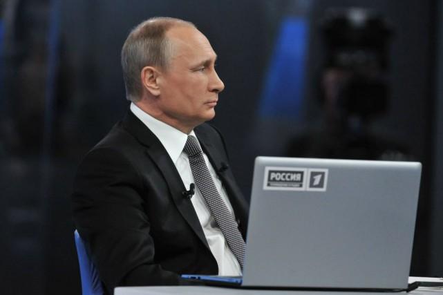Vladimir Poutine estime que cette décision est justifiée... (Photo Mikhail Klimentyev, RIA Novosti, Presidential Press Service, AP)