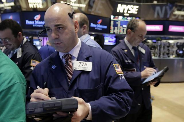 Wall Street a fini en forte baisse vendredi, prise d'inquiétude face à la... (Photo Richard Drew, AP)