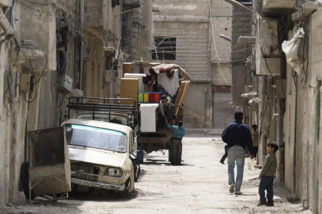 Selon l'ONU, près de 440 000 Syriens sont... (Photo Amer Almohibany, AFP)